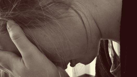 Woman anxiety depression despair sad crying